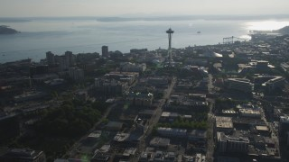 AX49_060 - 5K stock footage aerial video approach the world famous Space Needle in Downtown Seattle, Washington, with Elliott Bay in the background