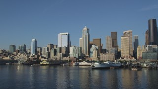 AX49_066 - 5K stock footage aerial video of the Downtown Seattle skyline and the Central Waterfront seen from Elliott Bay, Washington
