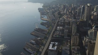 AX49_076 - Aerial stock footage of Orbit the Seattle Great Wheel, with a view of the Alaskan Way Viaduct and the Seattle Aquarium, Central Waterfront, Downtown Seattle, Washington