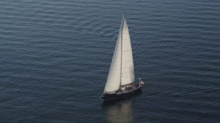 AX49_079 - 5K stock footage aerial video of a sailboat sailing on Elliott Bay, Seattle, Washington
