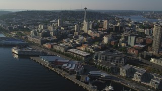 AX49_086 - 5K stock footage aerial video of the iconic Seattle Space Needle seen from Central Waterfront piers, Downtown Seattle, Washington