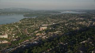 AX49_095 - 5K stock footage aerial video of suburbs in Rainier Valley, Seattle, Washington, and approach Lake Washington