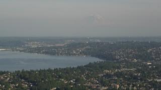 AX49_096 - 5K stock footage aerial video of homes around Lake Washington, and Mount Rainier in the background, Seattle, Washington