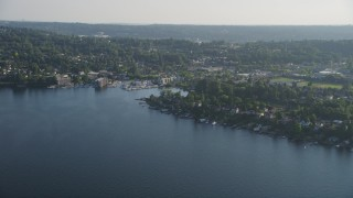 AX49_099 - 5K stock footage aerial video of lakefront homes on the shore of Lake Washington by marina, Rainier Beach, Seattle, Washington