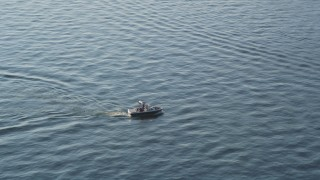AX49_101 - 5K stock footage aerial video of tracking a speedboat on Lake Washington, Seattle