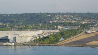 AX49_102 - 5K stock footage aerial video approach the Boeing Factory from Lake Washington in Renton, Washington