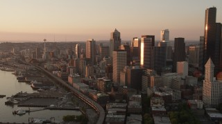 AX50_009 - 5K stock footage aerial video of Downtown Seattle skyscrapers and Central Waterfront piers in Washington, sunset