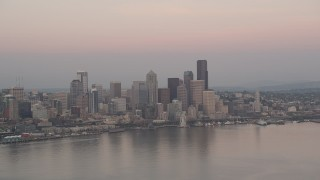 AX50_043 - 5K stock footage aerial video of a view of the Seattle Waterfront and the Downtown Seattle skyline from Elliott Bay in Washington, sunset