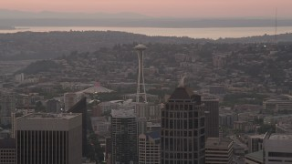 AX50_053 - 5K stock footage aerial video of Space Needle seen while passing skyscrapers in Downtown Seattle, Washington, sunset
