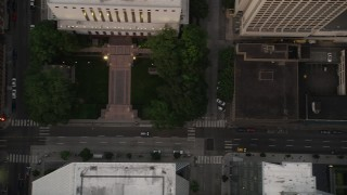 AX50_063 - 5K stock footage aerial video of bird's eye of 5th Avenue with light traffic and city buildings in Downtown Seattle, Washington, sunset