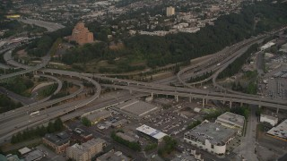 AX50_064 - 5K stock footage aerial video of the I-5 / I-90 interchange by Pacific Tower in Beacon Hill, Seattle, Washington, sunset