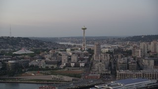 AX50_073 - 5K stock footage aerial video tilt from Elliott Bay to reveal the Seattle Space Needle and Central Waterfront piers in Downtown Seattle, Washington, sunset