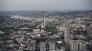 AX50_074 - 5K stock footage aerial video approach the Seattle Space Needle and Lake Union in the background, Downtown Seattle, Washington, sunset