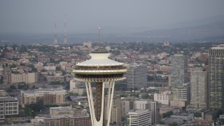 AX50_075 - 5K stock footage aerial video orbit the top of the world famous Seattle Space Needle in Downtown Seattle, Washington, sunset