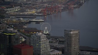 AX50_079 - 5K stock footage aerial video track the Seattle Great Wheel behind the Seattle Aquarium, Downtown Seattle, Washington, sunset