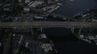AX50_084 - 5K stock footage aerial video of bird's eye view of light traffic crossing the Ship Canal Bridge, Seattle, Washington, twilight