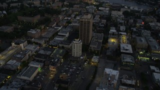 AX50_085 - 5K stock footage aerial video orbit University District office buildings, and tilt to reveal the bridge and Lake Union, Seattle, Washington, twilight