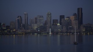 AX50_095 - 5K stock footage aerial video orbit sailboat to reveal Downtown Seattle skyline, Washington, twilight