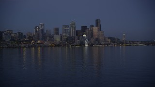AX50_096 - 5K stock footage aerial video of low approach to Downtown Seattle skyline at twilight, Washington
