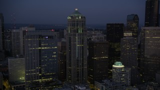 AX50_098 - 5K stock footage aerial video of approach and flyby 1201 Third Avenue Tower at twilight in Downtown Seattle, Washington
