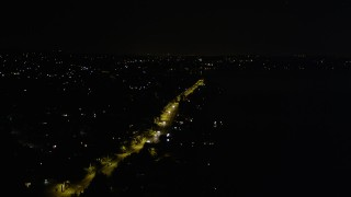 AX51_001 - 5K stock footage aerial video of Rainier Avenue with light traffic, Lakeridge, Washington, night