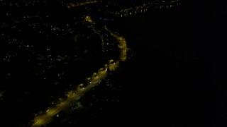 AX51_002 - 5K stock footage aerial video tilt to Rainer Avenue with light traffic in Lakeridge, Washington, night