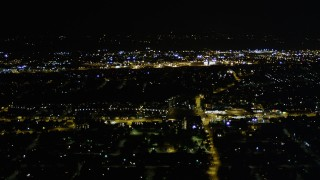 AX51_003 - 5K stock footage aerial video flyby the lights of suburban neighborhoods, Rainier Beach, Seattle, Washington, night