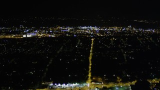 AX51_004 - 5K stock footage aerial video of dark suburban neighborhoods, Rainier Beach, Seattle, Washington, night