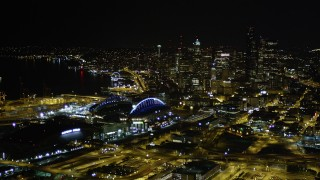 AX51_007 - 5K stock footage aerial video approach Safeco and CenturyLink Fields, with a view of Downtown Seattle skyscrapers, Washington, night