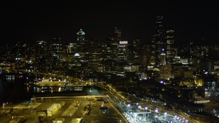 AX51_008 - 5K stock footage aerial video of Downtown Seattle skyscrapers at night seen from CenturyLink Field, Washington