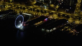 AX51_022 - 5K stock footage aerial video of the Seattle Great Wheel and the Alaskan Way Viaduct at the Central Waterfront, Downtown Seattle, Washington, night