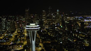 AX51_026 - 5K stock footage aerial video of a view of Downtown Seattle skyscrapers, reveal the Space Needle, Washington, night