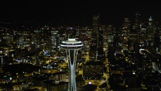 AX51_030 - 5K stock footage aerial video orbit the Space Needle and reveal Downtown Seattle skyscrapers in Washington at night