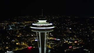 AX51_031 - 5K stock footage aerial video orbit Space Needle in Downtown Seattle, with Elliott Bay in the background, Washington, night