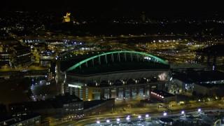 AX51_042 - 5K stock footage aerial video of CenturyLink Field football stadium in Downtown Seattle, Washington, night