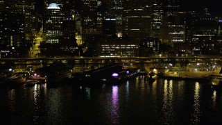 AX51_044 - 5K stock footage aerial video of Pier 54 on the Central Waterfront, Downtown Seattle, Washington, night