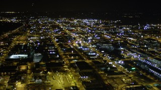 AX51_049 - 5K stock footage aerial video pan across warehouses and industrial buildings in the SoDo District, Seattle, Washington, night
