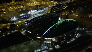 AX51_050 - 5K stock footage aerial video approach the CenturyLink Field football stadium in Downtown Seattle, Washington, night