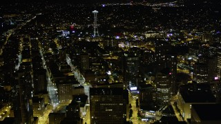 AX51_052 - 5K stock footage aerial video fly over skyscrapers in Downtown Seattle to approach the Space Needle, Washington, night