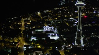 AX51_054 - 5K stock footage aerial video approach Pacific Science Center and the Space Needle, Downtown Seattle, Washington, night