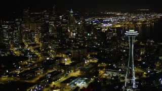 AX51_067 - 5K stock footage aerial video flyby the Space Needle to approach Downtown Seattle skyscrapers, Washington. night