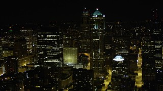 AX51_072 - 5K stock footage aerial video of passing skyscrapers and high-rises in Downtown Seattle, Washington, night