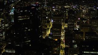 AX51_088 - 5K stock footage aerial video orbit Rainier Tower and Downtown Seattle skyscrapers, Washington, night