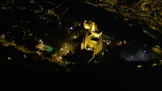 AX51_093 - 5K stock footage aerial video track the Pacific Tower medical center building in Beacon Hill, Seattle, Washington, night