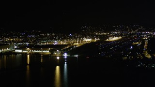 AX51_100 - 5K stock footage aerial video pan from Boeing Factory to approach Renton Municipal Airport, Washington, night