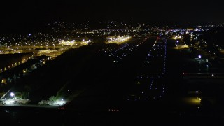 AX51_101 - 5K stock footage aerial video approach Renton Municipal Airport runway from Lake Washington, night