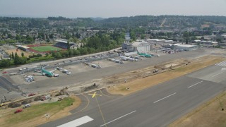 AX52_002 - 5K stock footage aerial video of parked airliners at Renton Municipal Airport, Washington