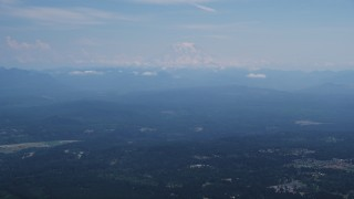 AX52_004 - 5K stock footage aerial video of Mount Rainier with snow, an active volcano in Cascade Range, Washington