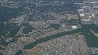 AX52_005 - 5K stock footage aerial video of reverse view of suburban neighborhoods in Renton, Washington