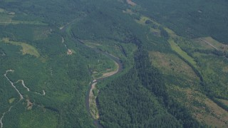 AX52_008 - 5K stock footage aerial video of Skookumchuck River and evergreen forest in Thurston County, Washington